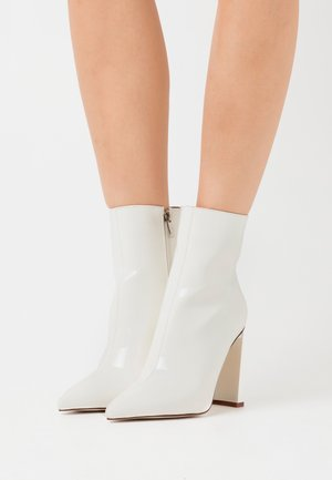 ELEXIS - High heeled ankle boots - white
