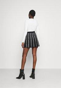 NIKKIE - KATY SKIRT - Mini skirt - black - 2