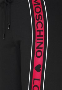 Love Moschino - Tracksuit bottoms - black - 5