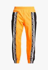 adidas Originals - REVEAL YOUR VOICE TRACKPANT - Tracksuit bottoms - flash orange - 4