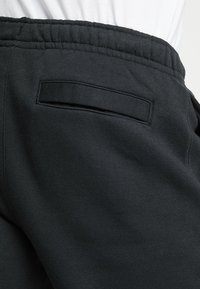 Nike Sportswear - CLUB - Tracksuit bottoms - black - 5