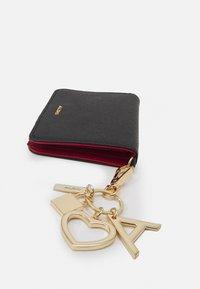 ALDO - DWENDASSA - Wallet - black/gold - 3