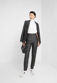 HUGO - HEBANAS - Trousers - black - 1