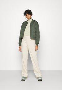 Monki - CLARA TOUSERS - Trousers - beige - 1