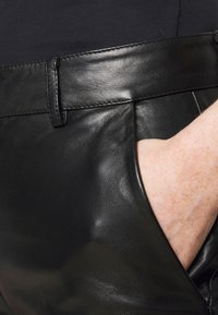 STUDIO ID - AMBER  - Leather trousers - black - 5