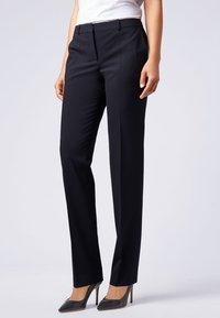 BOSS - TAMEA - Trousers - dark blue - 0
