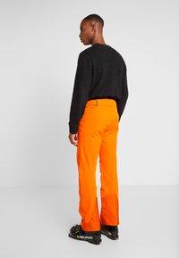 Kjus - MEN FORMULA PANTS - Snow pants - orange - 2