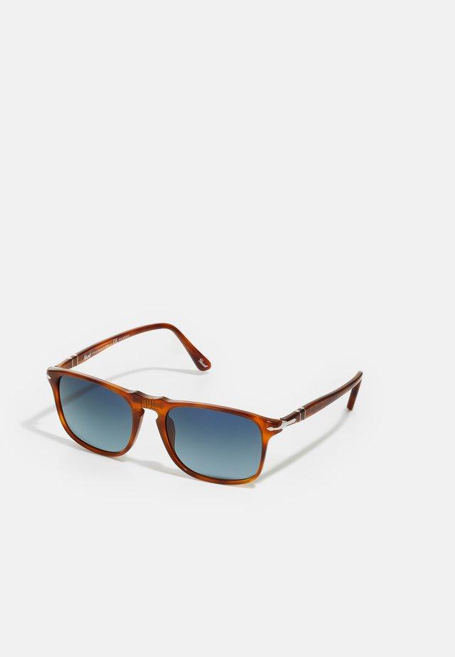 Sonnenbrille - terra di siena