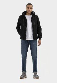 camel active - MIT STEHKRAGEN UND KAPUZE - Summer jacket - black - 1