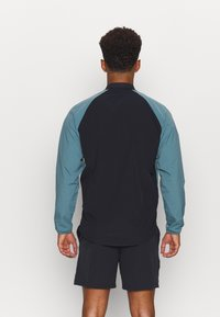 Under Armour - RIPSTOP WIND - Training jacket - black/green - 2
