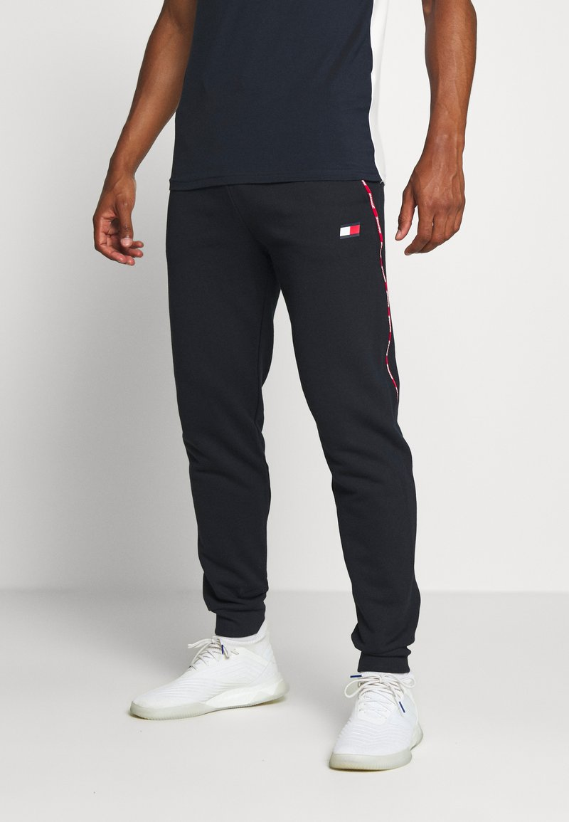 Tommy Hilfiger - PIPING CUFFED PANT - Tracksuit bottoms - blue