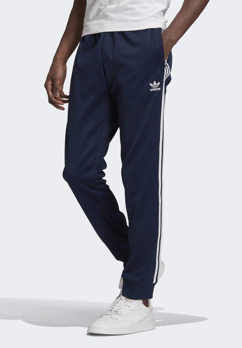 adidas Originals - ADICOLOR CLASSICS PRIMEBLUE SST TRACKSUIT BOTTOM - Spodnie treningowe - blue
