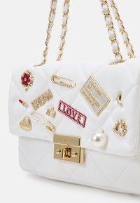 ALDO - GLIEVIA - Across body bag - bright white/gold-coloured - 3