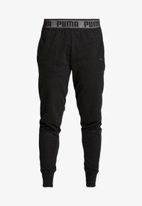 Puma - LOGO PANT - Teplákové kalhoty - black - 4