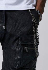 Tigha - Shorts - black - 3