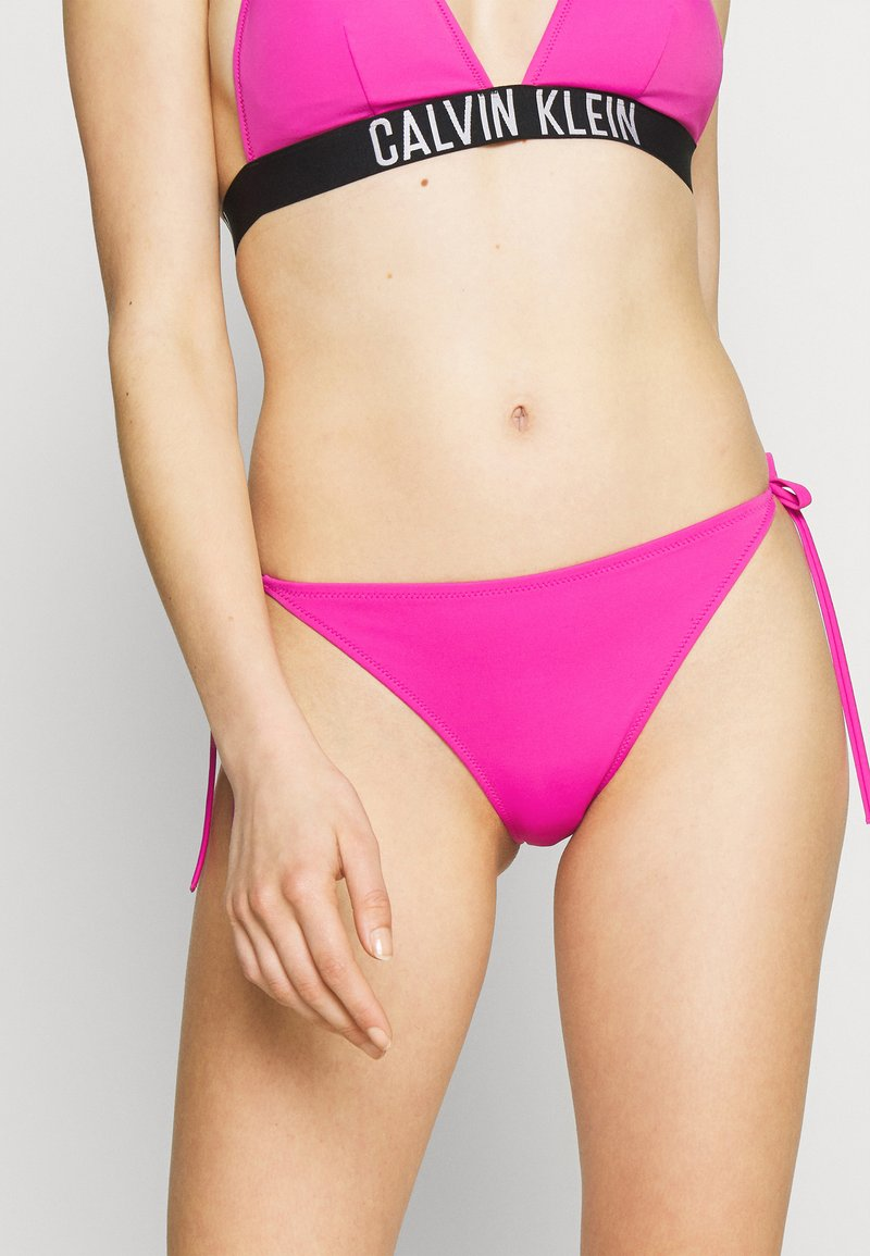 Calvin Klein Swimwear - INTENSE POWER CHEEKY STRING SIDE TIE - Bikini bottoms - stunning orchid