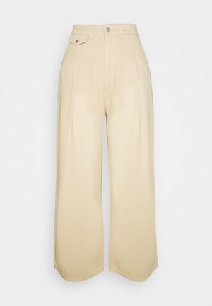 NANI TROUSERS - Vaqueros a campana - beige medium