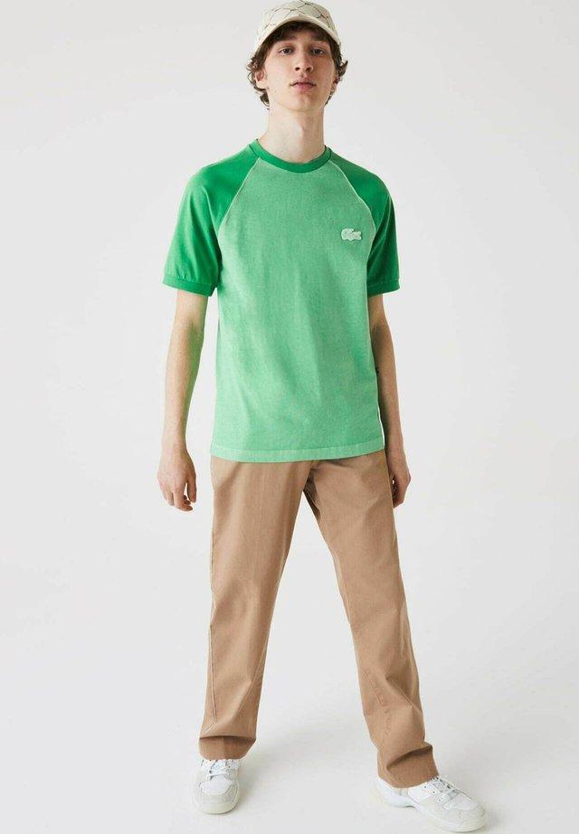 T-shirt imprimé - grün / grün