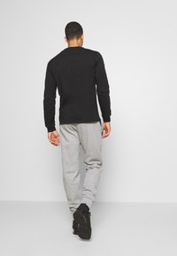 Champion - LEGACY CUFF PANTS - Tracksuit bottoms - mottled grey - 2
