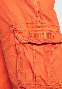 Schott - Cargo trousers - orange - 6