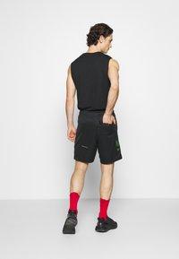 Nike Sportswear - Træningsbukser - black/green - 2