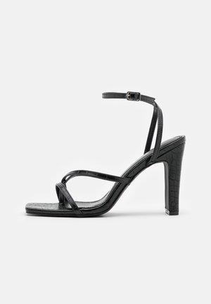 CAIRO - T-bar sandals - black