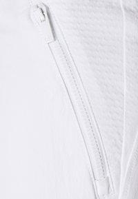 Calvin Klein Golf - ARKOSE TROUSER - Trousers - white - 5