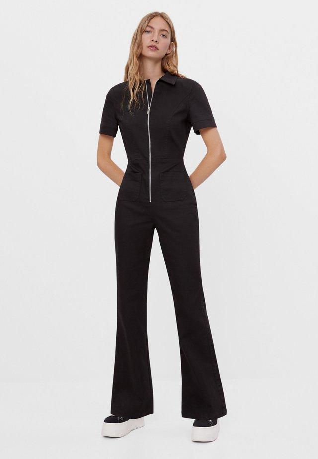 MIT AUSGESTELLTER HOSE UND REISSVERSCHLUSS - Overall / Jumpsuit - black