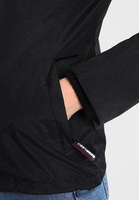 Superdry - TECH HOOD POP ZIP WINDCHEATER - Summer jacket - black/raspberry - 5