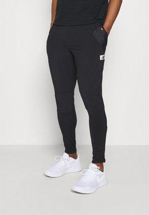 ALL TERRAIN PANT - Tracksuit bottoms - black