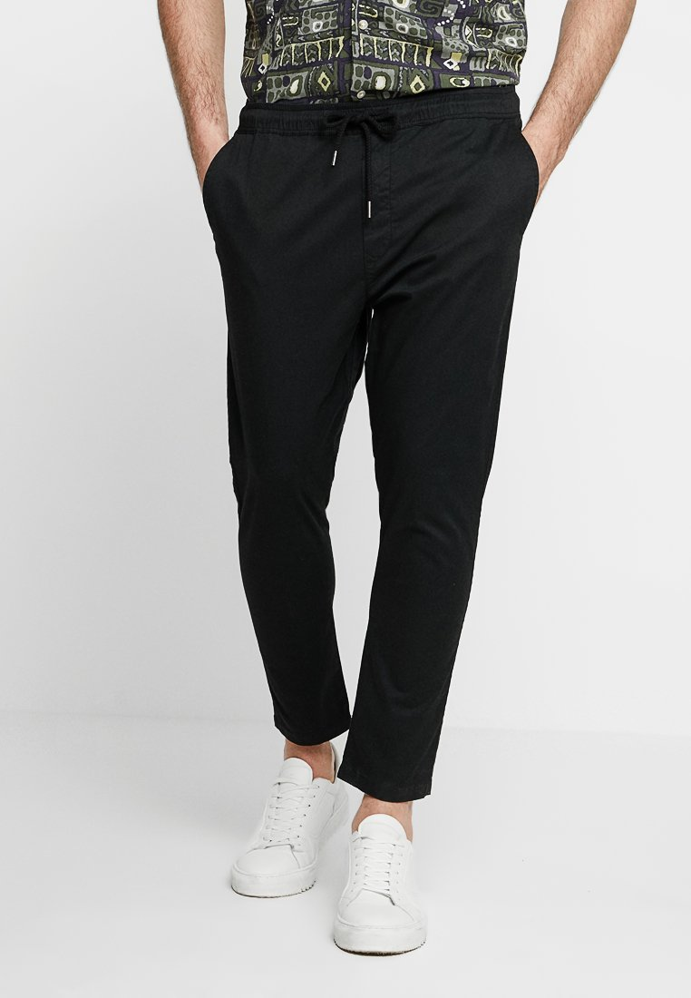 Solid - TRUC CROPPED - Trousers - black