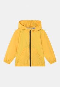 OVS - RAIN UNISEX - Waterproof jacket - blazing yellow - 0