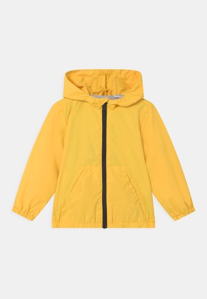 RAIN UNISEX - Waterproof jacket - blazing yellow