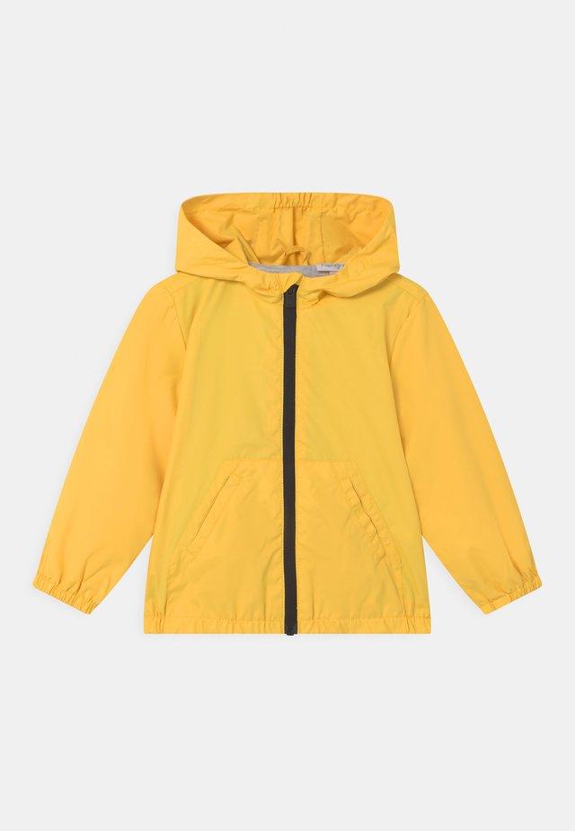 RAIN UNISEX - Regenjas - blazing yellow