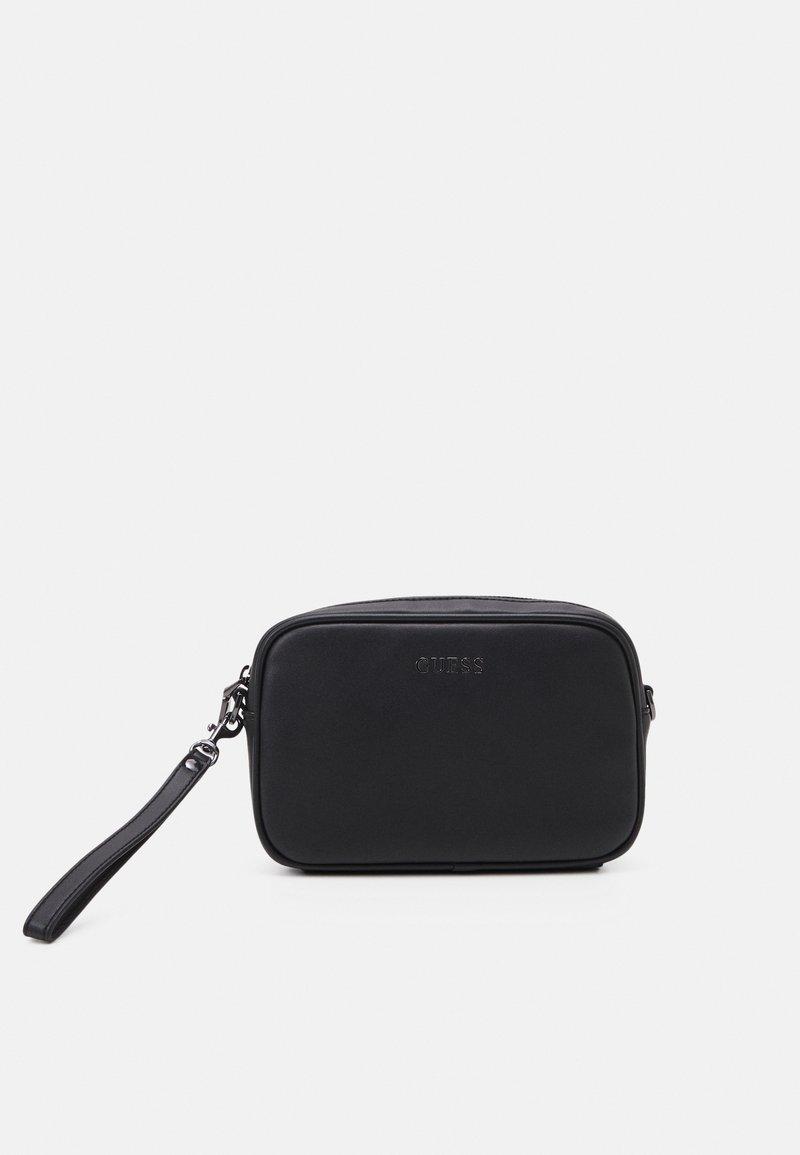 Guess - SCALA SMALL NECESSAIRE UNISEX - Trousse de toilette - black