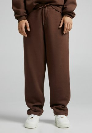 UNISEX WIDE FIT - Tracksuit bottoms - brown