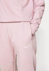 Nike Sportswear - Tracksuit bottoms - champagne - 3