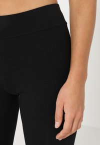 Puma - ESS LOGO - Tights - cotton black