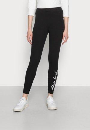 STRETCH SCRIPT  - Leggings - Trousers - black
