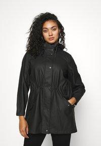 Vero Moda Curve - VMMALOU COATED - Waterproof jacket - black - 0