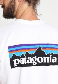 Patagonia - LOGO RESPONSIBILI TEE - Print T-shirt - white - 3