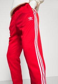 adidas Originals - Spodnie treningowe - red/white - 4