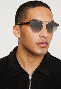 Prada - Sunglasses - grey/silver-coloured - 1