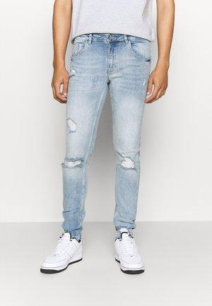 BARCELONA DESTROY - Slim fit jeans - bleach