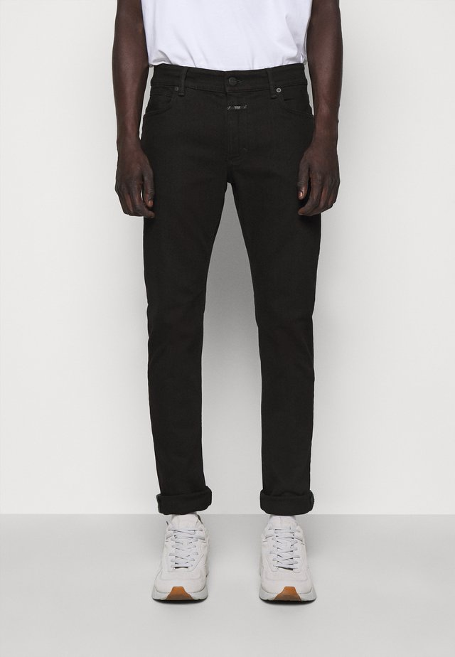 UNITY - Slim fit jeans - black