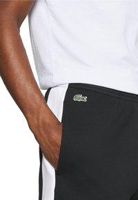 Lacoste - Pantaloni sportivi - noir/blanc - 3