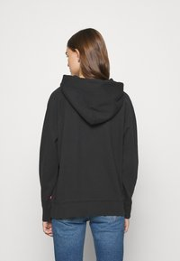 Levi's® - GRAPHIC SPORT HOODIE - Sweat à capuche - black - 2
