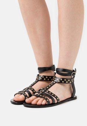 YASGLAZILLA  - Sandals - black