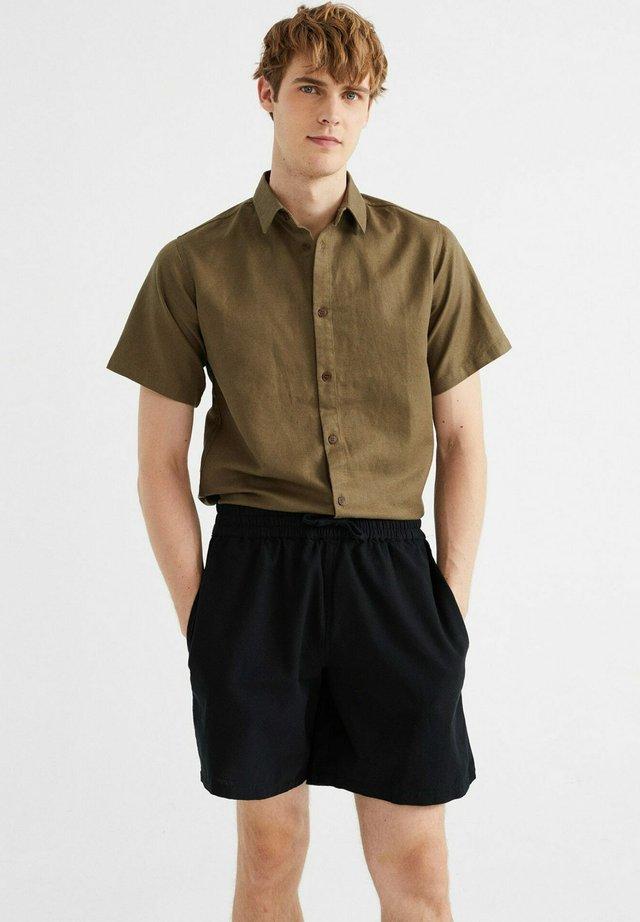 HENRY  - Shorts - black