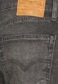 Levi's® - 502 TAPER - Slim fit jeans - blacks - 6
